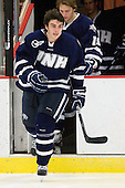 Trevor van Riemsdyk (UNH - 6), Casey Thrush (UNH - 19) - The Harvard University Crimson defeated the University of New Hampshire Wildcats 7-6 on Tuesday, November 22, 2011, at Bright Hockey Center in Cambridge, Massachusetts.