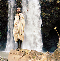Local man in front of the Tissisat Falls, Blue Nile, Lake Tana, North West Ethiopia