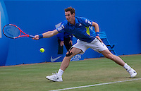Andy Murray (GBR) (3) against Mardy Fish (USA) in the third round of the men's singles. Mardy Fish beat Andy Murray 6-4 1-6 7-6..Tennis - ATP World Tour - AEGON Championships - Queen's Club - London - Day 4 - Thur 10 Jun 2010..© AMN Images - Level 1, Barry House, 20-22 Worple Road, London, SW19 4DH.Tel - +44 (0) 208 947 0100.email - mfrey@advantagemedianet.com. www.photoshelter.com/c/amnimages.