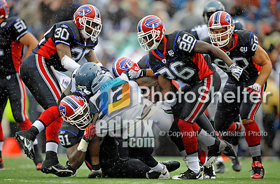 7 September 2008:  Buffalo Bills' defensive tackle Spencer Johnson (91) tackles Seattle Seahawks running back Julius Jones (22) during a game at Ralph Wilson Stadium in Orchard Park, NY. The Bills defeated the Seahawks 34-10 in the season opening game...Mandatory Photo Credit: Ed Wolfstein Photo