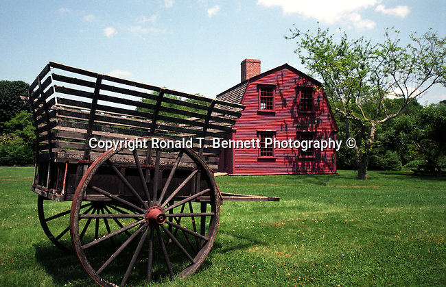 Wagon on green lawn with  New England home in background, wagon, red New England home, States, six-state region, Northeastern corner of United States, bordered by Atlantic Ocean, Canada and New York, Connecticut Massachusetts Rhode Island Maine New Hampshire Vermont, thriving tourist industry, Main New Hampshire, Pilgrims from the Kingdom of England, New World, colonies, Fine Art Photography by Ron Bennett, Fine Art, Fine Art photography, Art Photography, Copyright RonBennettPhotography.com © Fine Art Photography by Ron Bennett, Fine Art, Fine Art photography, Art Photography, Copyright RonBennettPhotography.com ©