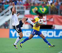 Abby Wambach (20) of the USWNT touches the ball away from Calandrini (3) of Brazil during an international friendly at the Florida Citrus Bowl in Orlando, FL.  The USWNT defeated Brazil, 4-1.
