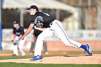 UNC Asheville Bulldogs starting pitcher Spencer Orr (14) delivers a pitch during a game against the Tennessee Volunteers at McCormick Field on March 15, 2016 in Asheville, North Carolina. The Volunteers defeated the Bull Dogs 7-3. (Tony Farlow/Four Seam Images)