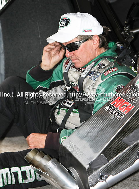John Force #9, driver for Castrol GTX/Ford Mustang's Funny Car taking a break during a rain delay at the O'Reilly Fall Nationals held at the Texas Motorplex in  Ennis, Texas.