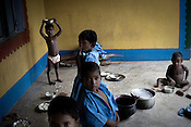 Children gather and eat their mid-day meal after a day of school in Godhari in Orcha block of Chattisgarh, India. Photo: Sanjit Das