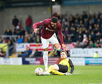 5th January 2020; Pirelli Stadium, Burton Upon Trent, Staffordshire, England; English FA Cup Football, Burton Albion versus Northampton Town; Stephen Quinn of Burton Albion wins a sliding tackle for the ball from Vadaine Oliver of Northampton Town  - Strictly Editorial Use Only. No use with unauthorized audio, video, data, fixture lists, club/league logos or 'live' services. Online in-match use limited to 120 images, no video emulation. No use in betting, games or single club/league/player publications