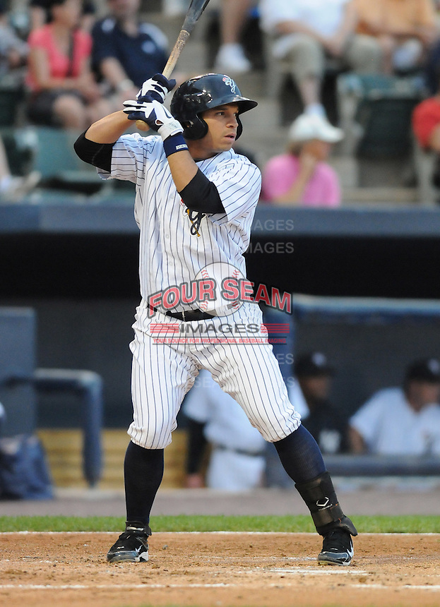 Infielder Luis Nunez (15) of the Scranton/Wilkes-Barre Yankees, International League affiliate of the New York Yankees, in a game against the Norfolk Tides on June 20, 2011, at PNC Park in Moosic, Pennsylvania. (Tom Priddy/Four Seam Images)