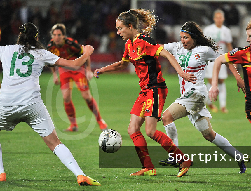 20131031 - ANTWERPEN , BELGIUM : Belgian Tessa Wullaert (middle) pictured with the Portugese Ana Borges (right) in her back  during the female soccer match between Belgium and Portugal , on the fourth matchday in group 5 of the UEFA qualifying round to the FIFA Women World Cup in Canada 2015 at Het Kiel stadium , Antwerp . Thursday 31st October 2013. PHOTO DAVID CATRY