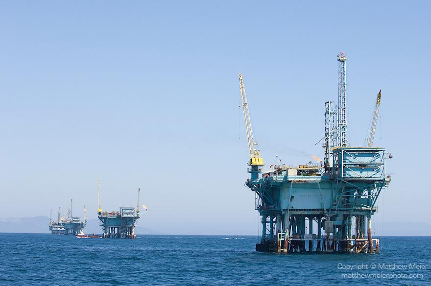 Santa Barbara, California; oil rigs off the coast of Santa Barbara, with fires lit burning off natural gas