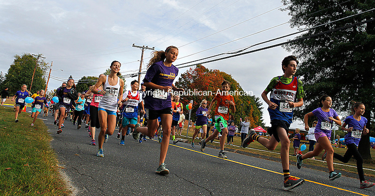 "WOODBURY, CT - 26 SEPTEMBER 2015 - 092615JW14.jpg -- Runners start off on the 5K portion of the 5th Annual Go The Distance For Scholars at Mitchell School in Woodbury Saturday morning. Last year, ""Go the Distance"" netted over $34,000 with proceeds fully supporting student scholarships. Jonathan Wilcox Republican-American"