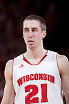 Wisconsin Badgers guard Josh Gasser (21) looks on during a Big Ten Conference NCAA college basketball game against the Illinois Fighting Illini on Sunday, March 4, 2012 in Madison, Wisconsin. The Badgers won 70-56. (Photo by David Stluka)