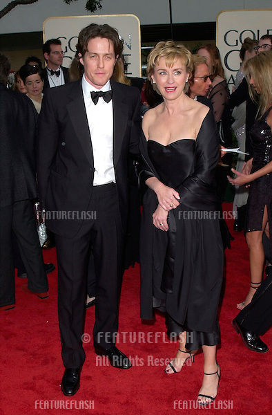 Actor HUGH GRANT with magazine editor/publisher TINA BROWN at the 2001 Golden Globe Awards at the Beverly Hilton Hotel..21JAN2001.  © Paul Smith/Featureflash