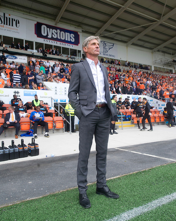 Blackpool manager Jos&eacute; Riga stands under a sign promoting the clubs owner Karl Oyston who is keen to see him leave the club just before kick-off<br /> <br /> Photographer Stephen White/CameraSport<br /> <br /> Football - The Football League Sky Bet Championship - Blackpool v Wolverhampton Wanderers - Saturday 13th September 2014 - Bloomfield Road - Blackpool<br /> <br /> &copy; CameraSport - 43 Linden Ave. Countesthorpe. Leicester. England. LE8 5PG - Tel: +44 (0) 116 277 4147 - admin@camerasport.com - www.camerasport.com