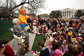 "Former first lady Barbara Bush reads, ""Aurther New Puppy,"" as a mascot of Aurther looks at the annual White House Easter Egg Roll March 24, 2008 on the South Lawn of the White House in Washington, DC. The Easter Egg Roll is a traditional all-American event held on the White House lawn each year since 1878, where kids compete by using a giant wooden spoon to push and egg.  BLOOMBERG POOL PHOTO Ken Cedeno<br /> Credit: Ken Cedeno / Pool via CNP"