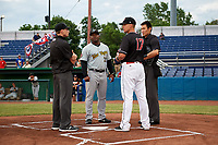 Batavia Muckdogs manager Mike Jacobs (17) meets with West Virginia Black Bears manager Kieran Mattison (22), umpire Tyler Witte and home plate umpire Jae-Young Kim before a game against the West Virginia Black Bears on June 18, 2018 at Dwyer Stadium in Batavia, New York.  Batavia defeated West Virginia 9-6.  (Mike Janes/Four Seam Images)