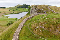 Northumberland,  England, UK.  Peel Crags from Steel Rigg, Hadrian's Wall Footpath.  Crag Lough on left.