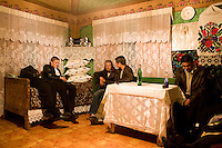 ROMANIA / Maramures / Budesti / 14.10.2006  .Young men visit with a young woman late at night. © Davin Ellicson / Anzenberger