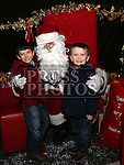 Dylan and Conor Kelly visiting Santa at the Laurence Centre.