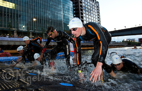 30 JUN 2011 - LONDON, GBR - Competitors leave the water at the end of the swim during the men's supersprint final at the GE Canary Wharf Triathlon. Pictured includes Cameron Milne (second from left) (PHOTO (C) NIGEL FARROW)
