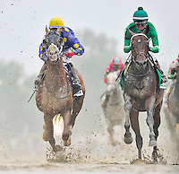 BALTIMORE, MD - MAY 21: Exaggerator #5 (green cap), ridden by Kent Desormeaux, trails the leaders the first time by the grandstand before closing to win the Preakness Stakes at Pimlico Race Course on May 21, 2016 in Baltimore, Maryland. (Photo by Scott Serio/Eclipse Sportswire/Getty Images)