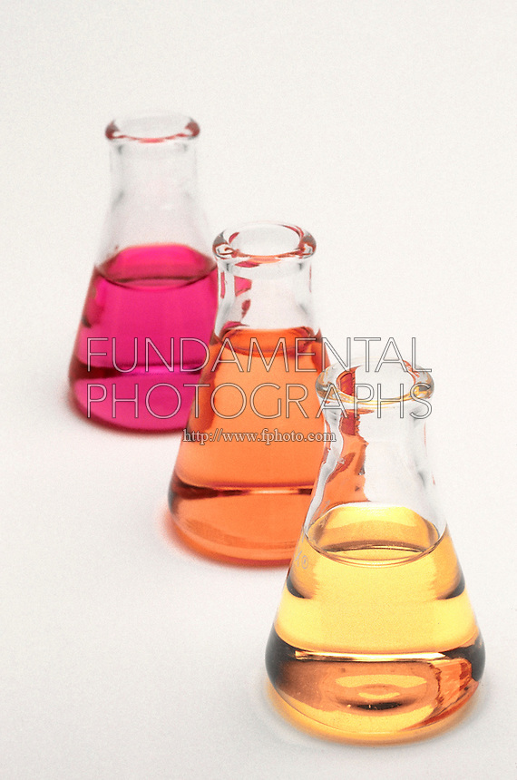 METHYL RED INDICATOR<br /> Three Acid/Base Solutions With Measured pH<br /> From top to bottom, solutions are measured at a pH of 2, 5 and 10. Solutions with a pH of 4.4 or less appear red when methyl red is added. Solutions with a pH greater than 6.2 are yellow.