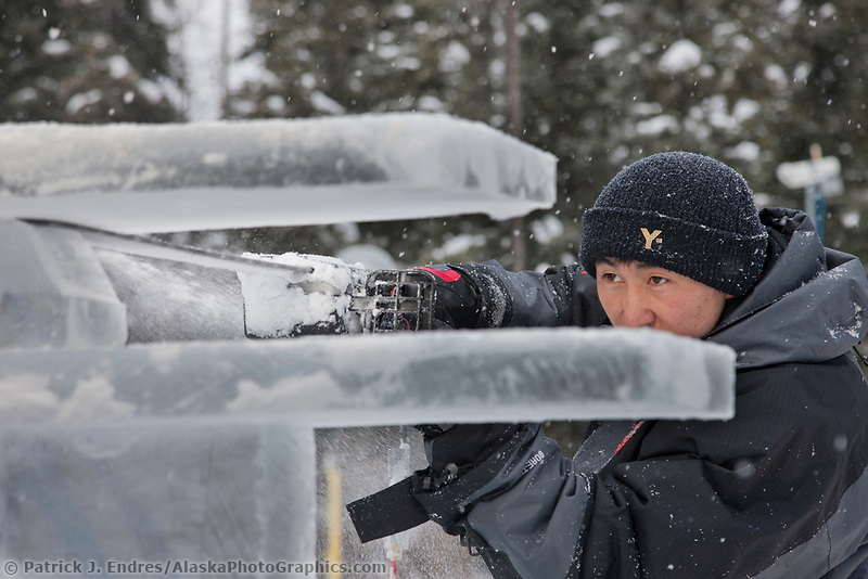 "Mongolian sculptors Dorjsuren Lkhagvadorj and Munkh-Erdene Tsagaan work on the abstract single block sculpture titled ""Ice Tomography"" for the 2009 World Ice Art Championships in Fairbanks, Alaska."