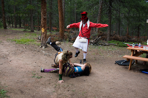 "LARPers from Dallas...The Nero Empire Live Action Role Players (LARP) gather for a three day LARPING event in forest land outside of Conifer, Colo.  LARPING is a scenario-based event where participants create characters for themselves and participate in play based around that theme.  Characters form alliances, fight for common goals, and can be ""killed."""