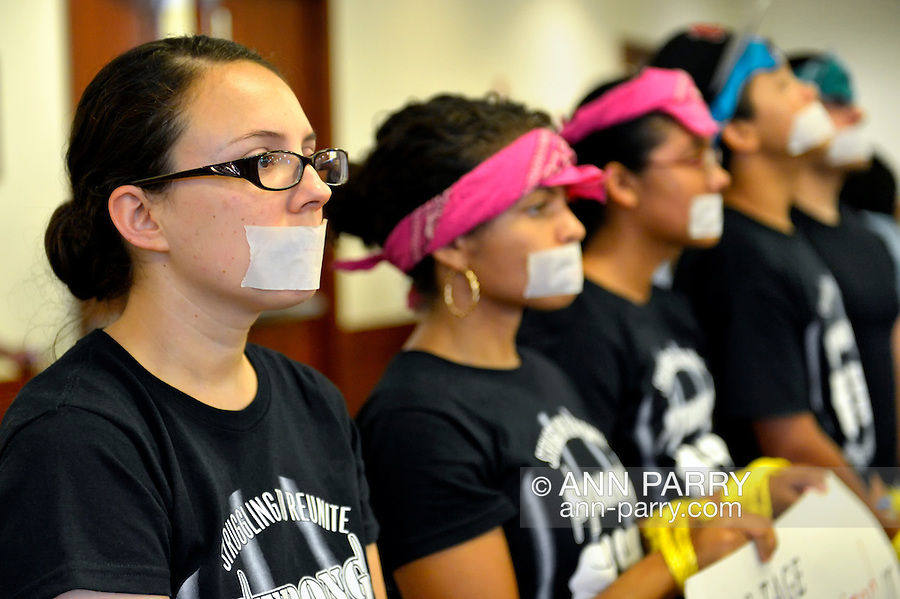 AUG. 6, 2012 - Mineola, New York, U.S. - At Nassau County Legislature Meeting, protestors from Strong Youth Inc had tape over their mouths and rope binding their hands, symbolic of having no voice or power over  cuts to youth services. Many protestors attended in effort to restore youth and family service funding, after Nassau County Executive Ed Mangano cut over 7 million dollars from dozens of private youth agencies and mental health and addiction treatment agencies in July.
