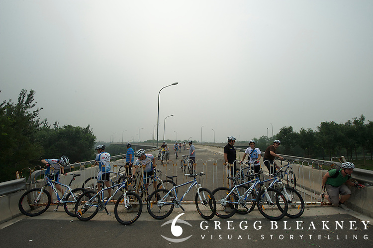 Time Trail Course, KM 5-7, this dead-end freeway section will be completed and linked via a sharp banked turn to a section of course through a wooded park - Journalists and delegates pre-ride the 2011 Tour of Beijing Scouting Photos