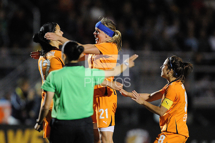 Jessica Landström (12) and Kacey White (8) congratulate Laura Kalmari (21) on her goal.  FC Gold Pride defeated Sky Blue FC 3-1 at Castro Valley HS Athletic Stadium in Castro Valley, California on April 17, 2010.