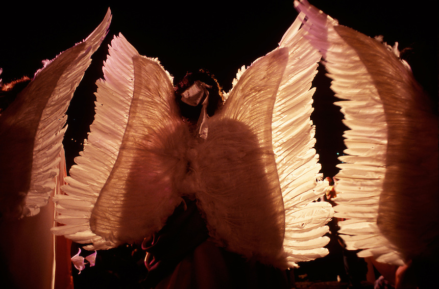 Wearing huge feather wings, three young angels preside over theatrical reenactments of the Last Supper and Passion of Jesus staged annually by several of the town's churches. Itself an historical landmark, the town of 60,000 boasts 13 huge 18th-century churches