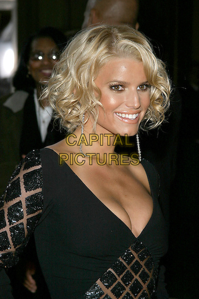 JESSICA SIMPSON.31st Annual People's Choice Awards held at the Pasadena Civic Auditorium. .January 9th, 2004.Photo Credit: Jacqui Wong/AdMedia..headshot, portrait, plunging neckline, cleavage, black sequins, diamond pattern, dangling earrings.www.capitalpictures.com.sales@capitalpictures.com.© Capital Pictures.