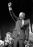 1990 File Photo.<br /> South African opposition leader Nelson Mandela (R) raise his fist to salute the crowd right after his speech in front the black community in Montreal (Quebec, Canada) on June 20, 1990, while Jean Doré (L) ; the Mayor of Montréal at that time is applauding.<br /> Photo by Pierre Roussel,IMAGES DISTRIBUTION