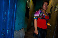 A Salvadoran sex worker stands in front of a room where her sexual services are offered to clients in San Salvador, El Salvador, 15 February 2014. Although prostitution is not legal in El Salvador, dozens of street sex workers, wearing provocative miniskirts, hang out in the dirty streets close to the capital's historic center. Sex workers of all ages are seen on the streets but a significant part of them are single mothers abandoned by their male partners. Due to the absence of state social programs, they often seek solutions to their economic problems in sex work. The environment of street sex business is strongly competitive and dangerous, closely tied to the criminal networks (street gangs) that demand extortion payments. Therefore, sex workers employ any tool at their disposal to struggle hard, either with their fellow workers, with violent clients or with gang members who operate in the harsh world of street prostitution.