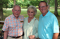 NWA Democrat-Gazette/CARIN SCHOPPMEYER Ed and Carol Clifford (from left) and Mike Luttrell attend the Jones Center Wine Walk.
