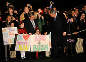 Washington, DC - November 11, 2008 -- United States President George W. Bush is greeted by a group of children as he arrives at the White House, following a day trip to New York where he precipitated in a Veteran's Day rededication ceremony of the U.S.S. Intrepid, in Washington on Tuesday, November 11, 2008. <br /> Credit: Kevin Dietsch - Pool via CNP