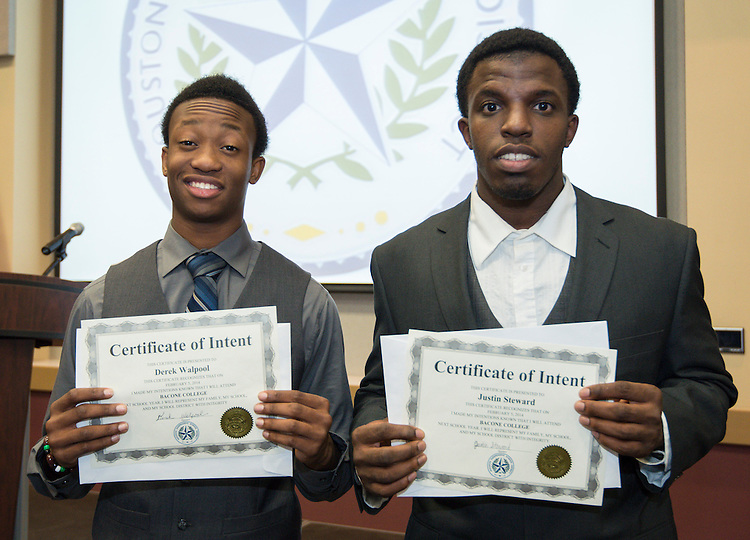 Scarborough's Derek Walpool (Bacone College) and Justin Steward (Bacone College) pose for a photograph during a National Signing Day ceremony at the Region 4 Education Center, February 5, 2014.