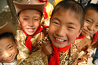 On a break form study, children in their national costume gather and play in the courtyard of Lhasa's first elementary school.