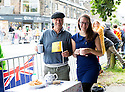Grand Depart - Tour de France 2014<br /> Yorkshire England.<br /> Leaders go through famous town of Ilkley with Moors in distance.<br /> <br /> Fans with beret and pots of tea<br /> <br /> Pic by Gavin Rodgers/Pixel 8000 Ltd