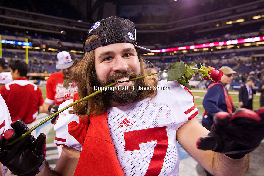 Wisconsin Badgers linebacker A.J. Fenton (17) celebrates winning the Big Ten Conference Championship NCAA college football game against the Michigan State Spartans on December 3 , 2011 in Indianapolis, Indiana. The Badgers won 42-39. (Photo by David Stluka)