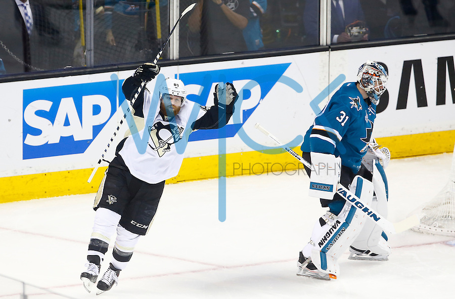 Phil Kessel #81 of the Pittsburgh Penguins celebrates his assist on the goal by Ian Cole #28 of the Pittsburgh Penguins in the first period against the San Jose Sharks during game four of the Stanley Cup Final at the SAP Center in San Jose, California on June 6, 2016. (Photo by Jared Wickerham / DKPS)