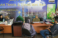 January 10, 2015 - Rawang (Malaysia). Customers at the Global Ikhwan travel agency in Rawang. The enterprise, which employs 4,000 people worldwide through its complicated network of subsidiaries, operates restaurants, clothing shops, noodle factories and health clinics in Malaysia, Indonesia, Thailand, Middle East and Australia. © Thomas Cristofoletti / Ruom
