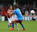 Stefan Scougall of Sheffield Utd tussles with Harry Toffolo of Scunthorpe Utd during the English League One match at Glanford Park Stadium, Scunthorpe. Picture date: September 24th, 2016. Pic Simon Bellis/Sportimage