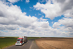 A cattle truck travels a lonely highway beneath a skyscape in Washington's high desert east of the Columbia River...**Trucking company logos removed in post production.