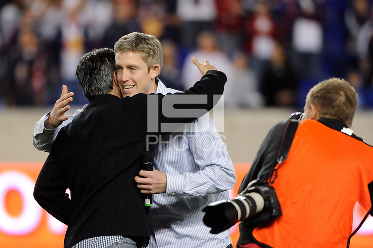 New York Red Bulls general manager and sporting director Erik Soler hugs John Wolyniec during a pre-game ceremony. The New York Red Bulls defeated the Kansas City Wizards 1-0 during a Major League Soccer (MLS) match at Red Bull Arena in Harrison, NJ, on October 02, 2010.
