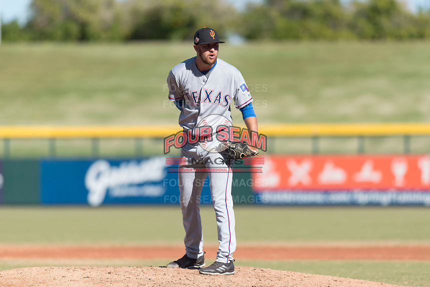Surprise Saguaros relief pitcher Joe Kuzia (52), of the Texas Rangers organization, looks in for the sign during an Arizona Fall League game against the Mesa Solar Sox at Sloan Park on November 15, 2018 in Mesa, Arizona. Mesa defeated Surprise 11-10. (Zachary Lucy/Four Seam Images)