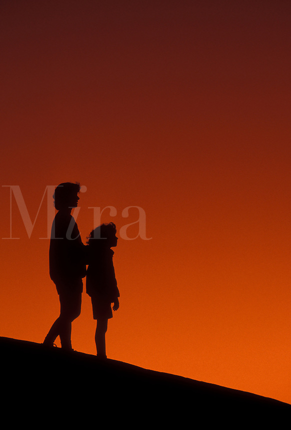 AJ4089, overlook, Silhouette, people, Stone Mountain, Georgia's Stone Mountain Park, Atlanta, Georgia, Silhouette of mother and young daughter watching/looking at sunset on the summit of Stone Mountain in Georgia's Stone Mt. Park near Atlanta in the state of Georgia.