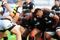 The Saracens front row of Petrus du Plessis, Jamie George and Mako Vunipola prepare to scrummage. Aviva Premiership match, between Saracens and Wasps on October 9, 2016 at Allianz Park in London, England. Photo by: Patrick Khachfe / JMP