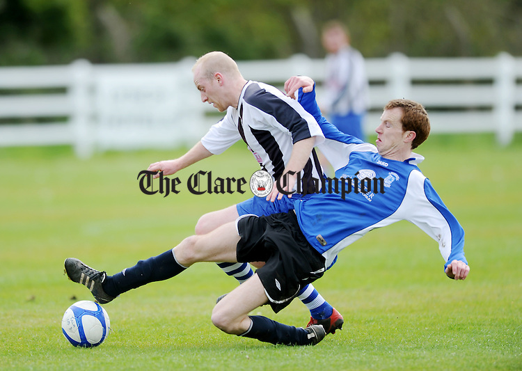 Noel Frawley puts in a sliding tackle on Tulla's John Brigdale. Photograph by Declan Monaghan
