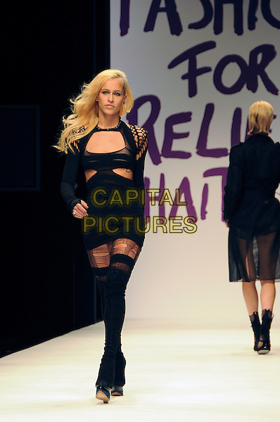 ALICE DELLAL.The Fashion For Relief Haiti 2010 show for London Fashion Week Autumn/Winter 2010 at Somerset House, London, England..February 18th, 2010.LFW catwalk runway full length black dress sleeveless platform wedges boots sock thigh high tights ripped torn but out away .CAP/CAS.©Bob Cass/Capital Pictures.